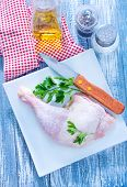 foto of charcuterie  - chicken leg on plate and on a table - JPG