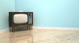 picture of tv sets  - An old vintage television set in the corner of an empty room with light blue wall and a reflective wooden floor - JPG