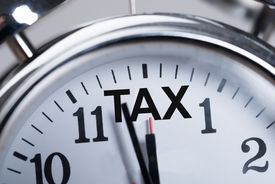 stock photo of countdown timer  - Cropped image of alarmclock showing arrival of tax time - JPG
