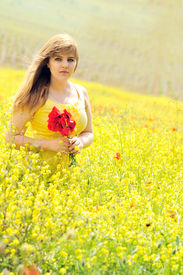 stock photo of rap-girl  - girl with bouquet of poppies in the raps field - JPG
