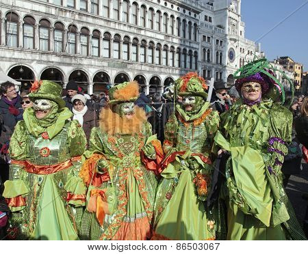 Masked Persons In Costume On San Marco Square In Venice, Italy.