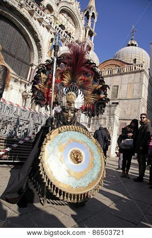Masked Man In Warrior Costume On San Marco Square During The Carnival In Venice, Italy.