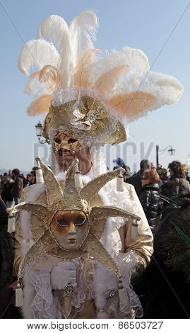 Masked Man In Costume On San Marco Square During The Carnival In Venice, Italy.