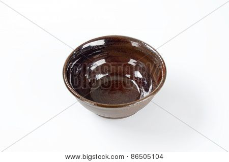 empty brown bowl on white background