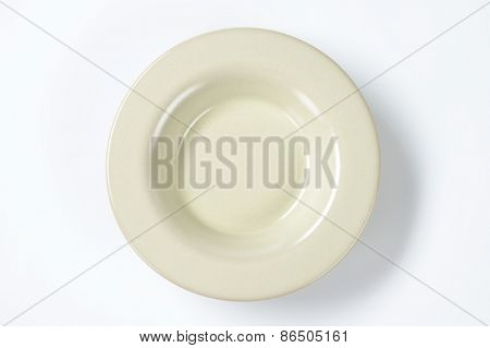 creamy soup plate on white background