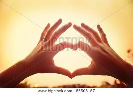 Heart symbol at sunset. Filtered instagram effect.