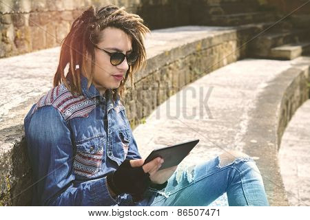 Freelancer Guy With Dreadlocks Warm Filter Applied