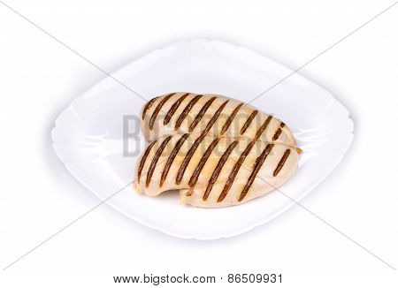 Chicken grilled fillet with slices on plate.