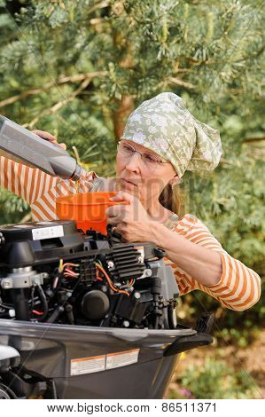 Woman Pouring Oil Into Outboard Motor