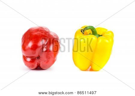 Red and yellow sweet peppers.