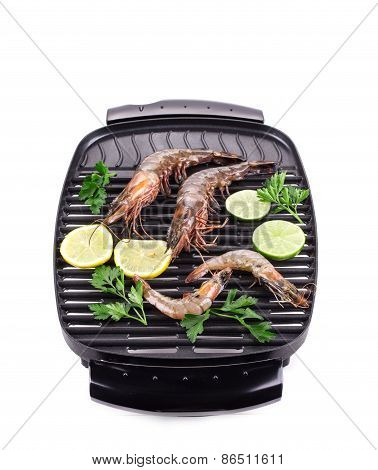 Fresh shrimps on a grill.
