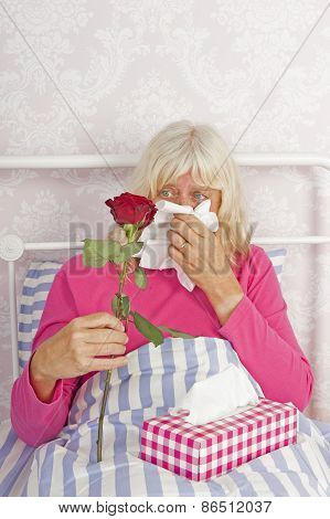 Sick Woman In Bed With Roses And Tissues