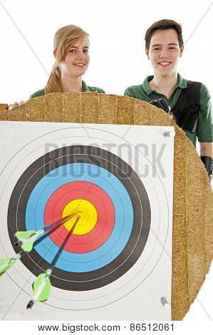Girl And Boy Behind Bull's Eye
