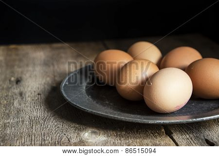 Fresh Eggs On Pewter Plate In Vintage Retro Style Natural Lighting Set Up