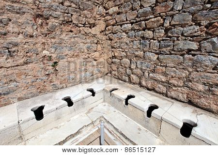 Public Multi-seat Toilet At Spectacular, Well Restored, Antique Ruins In Ephesus, Turkey
