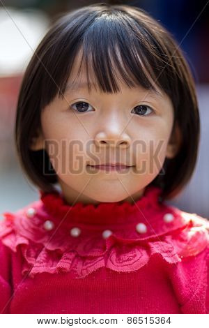 MAI CHAU, VIETNAM, DECEMBER 20, 2014: Portrait of a Vietnamese little girl in the street of the Thai ethnic village of Mai Chau, Vietnam