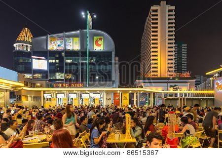 BANGKOK, THAILAND, DECEMBER 25, 2014: Thai people are celebrating Christmas at a outdoors restaurant in the Central World plaza in Bangkok, Thailand.