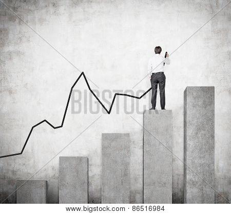 Businessman Drawing Arrow