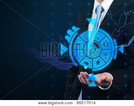 Businessman Holding Business Icons