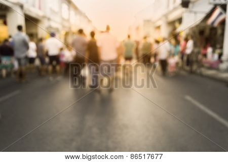Blurred People Watching A Performance On The Street