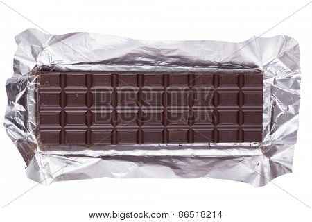Dark chocolate bar in opened foil wrapping, isolated on white background