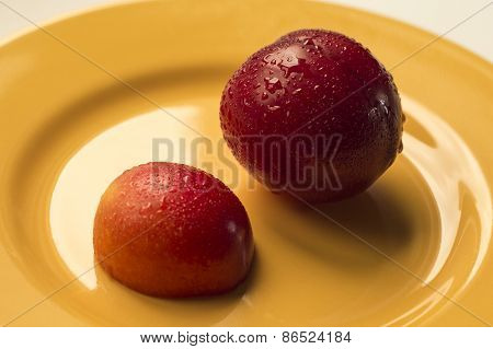 Victoria plum on yellow plate