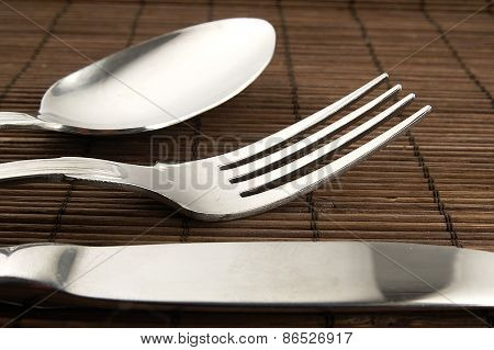 Cutlery On A Wooden Background.