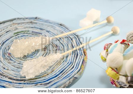 Two Sugar Sticks On A Blue Tablecoth