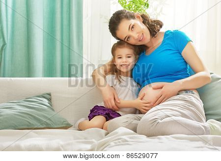 happy pregnant woman with her child