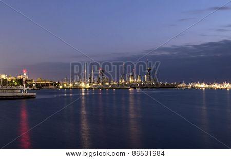 Battleship In Harbor At Night