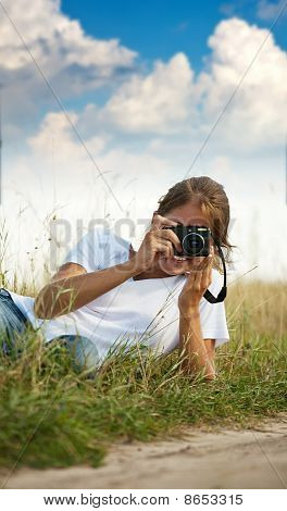 Girl Taking Photo With Camera