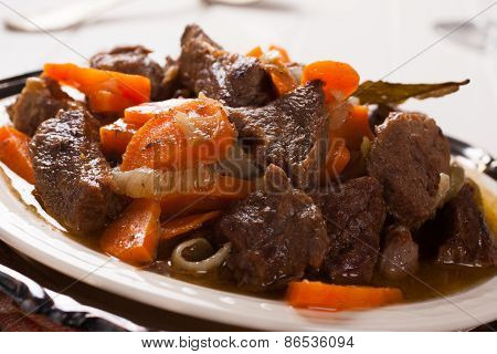 Plate of beef stroganoff with carrot