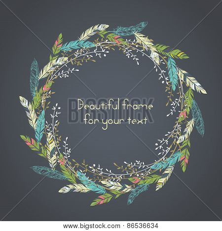 Beautiful round frame with feathers and some floral elements.