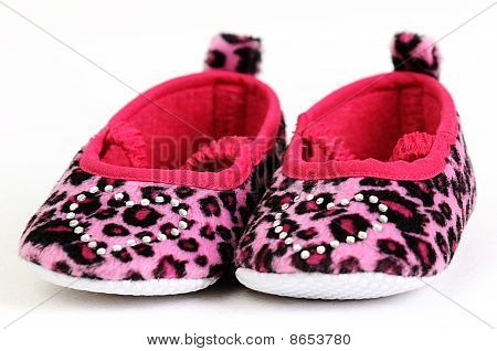 pink and red baby shoes with a crystal heart on
