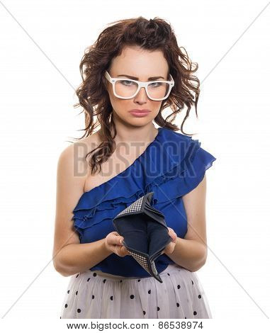 Young Sad Girl Looking At Her Empty Wallet, Isolated On White. Bankruptcy