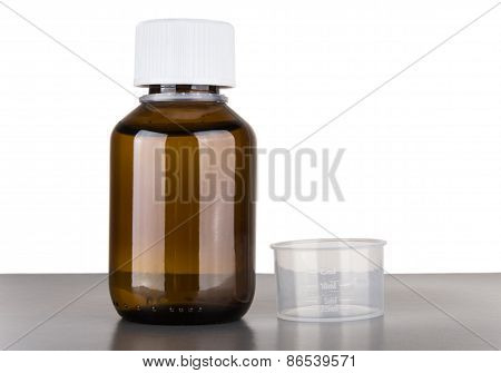 Bottle Of Cough Syrup And Volumetric Capacity