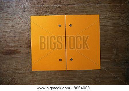 Orange Paper On Wooden Table