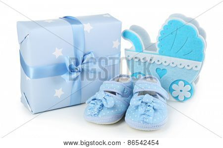 Baby shoes with gifts isolated on white