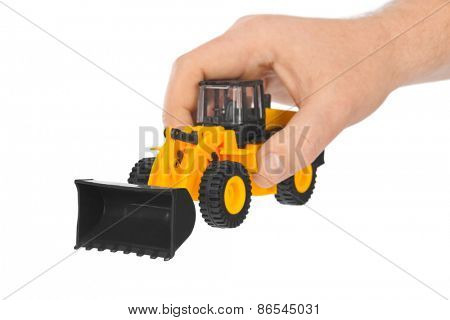 Hand with toy loader isolated on white background
