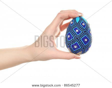 Easter egg in female hand isolated on white