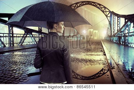 Businesswoman standing in the rain