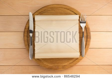 kitchen utensils at cutting board on wooden background