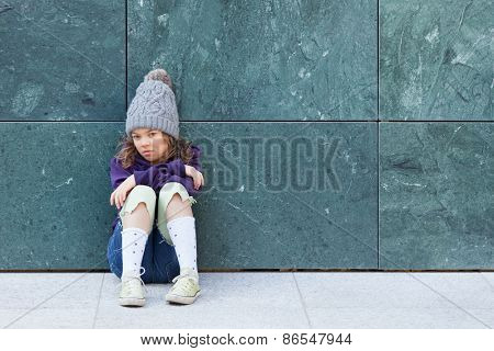 portrait of a casual little girl with wool hat, outdoors