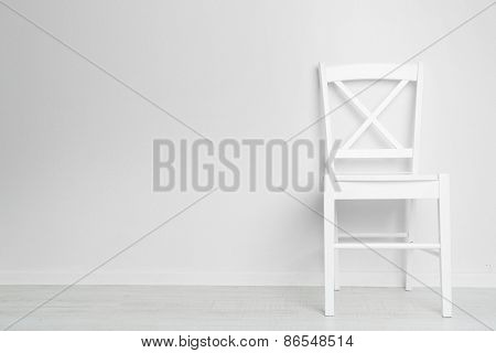 Modern chair on white wall background