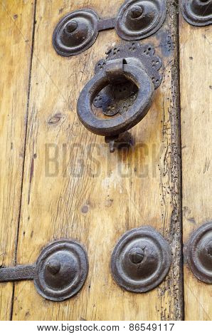 Forefront of the handle of a wooden door
