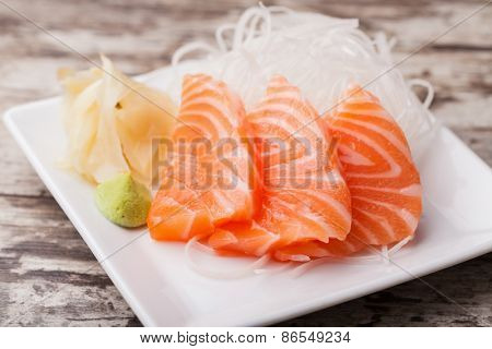 Salmon sashimi with withe plate