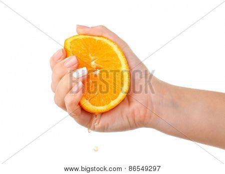 Female hand squeezing orange isolated on white