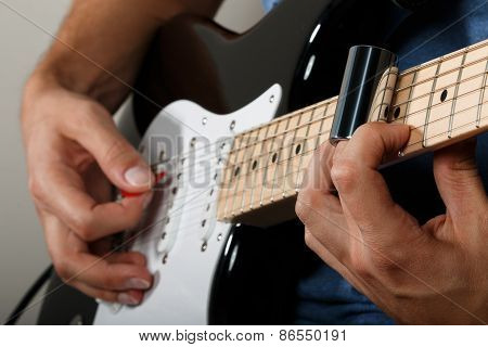 Electric Guitar Player Performing Song