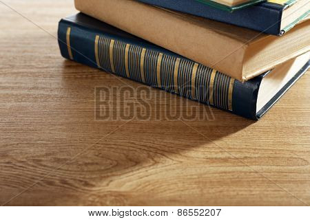 Old books on wooden table background