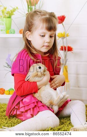Thoughtful Girl With A Rabbit